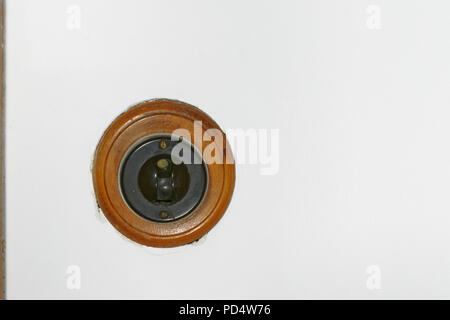 Old fashioned bakelite light switch with a wood surround - Stock Photo