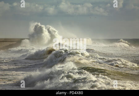 Big waves against Leixoes harbor north wall - Stock Photo