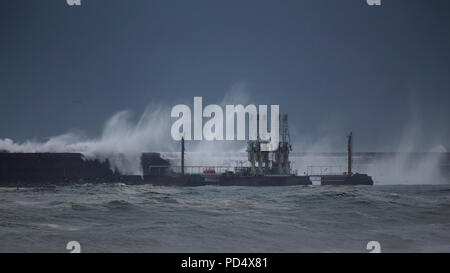 Leixoes harbor south pier in a stormy day seeing an oil discharge terminal, north of Portugal - Stock Photo