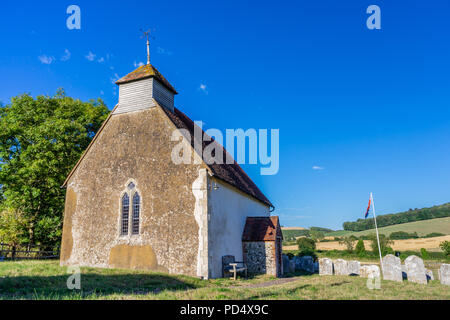 St Mary's Church in Upwaltham - a small 12th century church in Upwaltham surrounded by countryside and blue sky, Upwaltham, West Sussex, England, UK - Stock Photo
