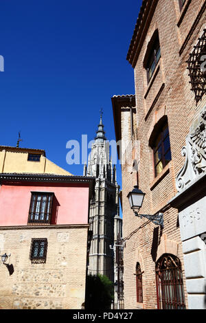 Historic street and tower of Primate Cathedral of St Mary, Toledo, Castile-La Mancha, Spain - Stock Photo