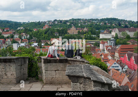 05.06.2017, Tuebingen, Baden-Wuerttemberg, Germany, Europe - A man and a woman enjoy the view from the Castle Hohentuebingen over Tuebingen's old town - Stock Photo