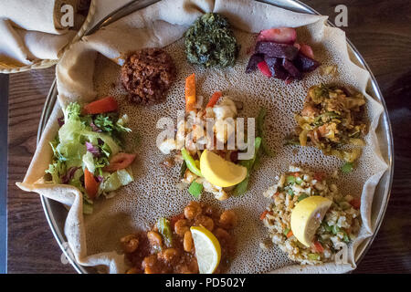 African food.  Injera is a sourdough flatbread made from teff flour.  It is the national dish of Ethiopia, Eritrea, Somalia and Djibouti - Stock Photo