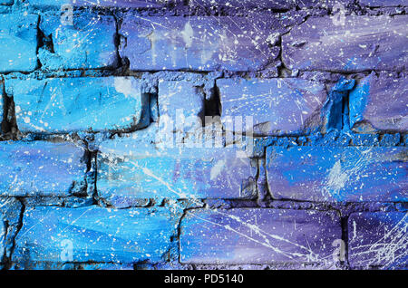 The texture of the old brick wall, painted in blue and purple colors with carelessly spaced white drops and splashes that visualize the stars in outer - Stock Photo