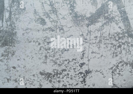 Background image with a concrete wall, painted in shiny silver color using aerosol chrome-plated paint for drawing graffiti - Stock Photo