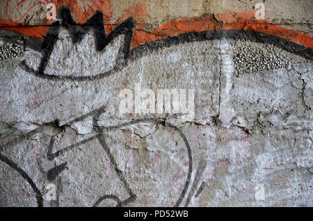 Detailed image of very old and aged color graffiti drawing on the wall. Background grunge street art picture - Stock Photo