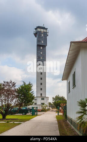 The modern monolithic Sullivan's Island Lighthouse, the last major lighthouse built by the federal government, resembles an air traffic control tower. - Stock Photo