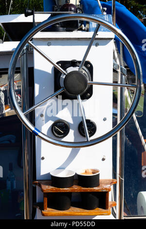 Sailing yacht control wheel and helm, two cups of coffee - Stock Photo