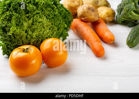 Rainbow colored fruits and vegetables on a white table. Juice and smoothie ingredients. Healthy eating diet concept. - Stock Photo