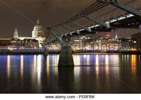 The London Millennium Footbridge over the River Thames at night - Stock Photo