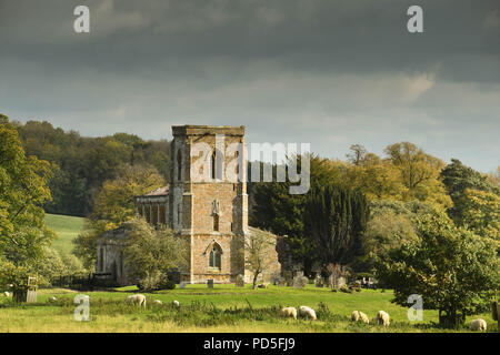 The medieval Church of St Mary the Virgin near Daventry, Northamptonshire, England, which is in a rural setting surrounded by fields and trees. - Stock Photo