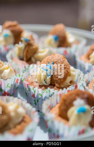 Mums homemade carrot cupcakes with cream cheese filling. - Stock Photo