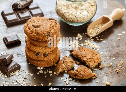 Homemade whole wheat oatmeal cookies with chocolate chips. Tasty healthy snack for Breakfast. Selective focus - Stock Photo