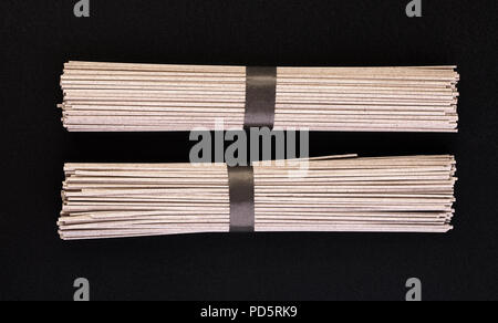 Japanese buckwheat noodles on a black background - Stock Photo