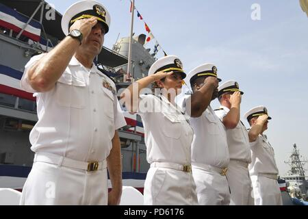 180711-N-TB177-1031 MANAMA, Bahrain (July 11, 2018) Officers salute during a change of command ceremony for the Avenger-class mine countermeasures ship USS Gladiator (MCM 11) on Naval Support Activity Bahrain, July 11, 2018. Gladiator is forward deployed to the U.S. 5th Fleet area of operations in support of naval operations to ensure maritime stability and security in the Central region, connecting the Mediterranean and the Pacific through the western Indian Ocean and three strategic choke points. (U.S. Navy photo by Mass Communication Specialist 2nd Class Kevin J. Steinberg/Released). () - Stock Photo
