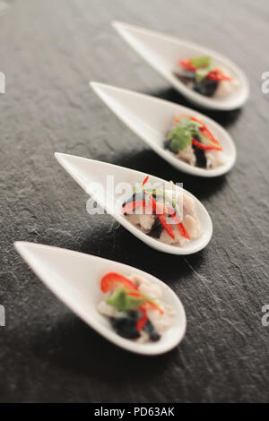 plated cocktail canapes - Stock Photo