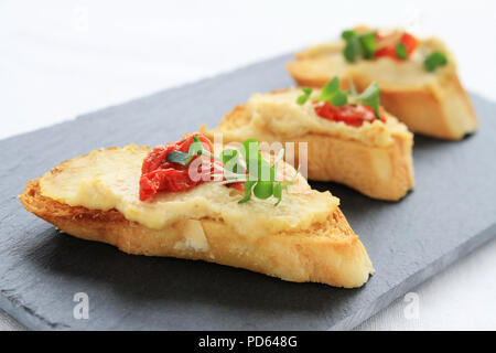 making bruschetta canapes - Stock Photo