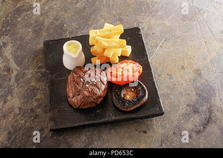 plated fillet steak meal - Stock Photo