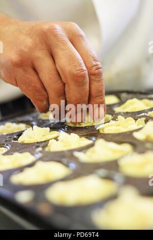 chef making bakewell tarts - Stock Photo