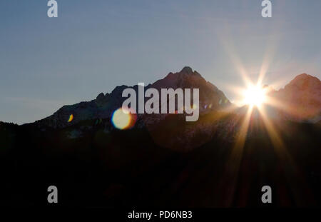 Sun shines over the mountains - Stock Photo