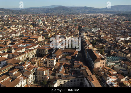 Great Synagogue of Florence also known as the Tempio Maggiore rising over the tiled roofs of the Florence downtown pictured from the dome of the Florence Cathedral (Duomo di Firenze) in Florence, Tuscany, Italy. - Stock Photo