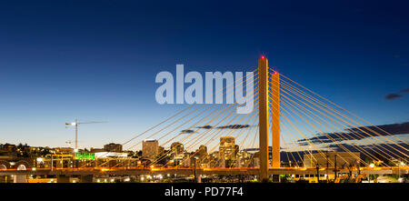 East 21st Street over Thea Foss Waterway in Tacoma Washington during evening blue hour panorama - Stock Photo