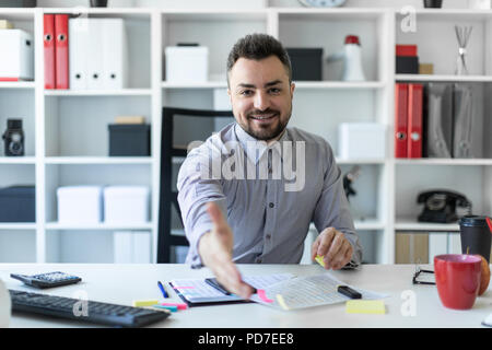 Businessman greeting someone stock photo 168681288 alamy business man greeting someone outside a bank a young man sits at a table in the office and holds out his hand m4hsunfo