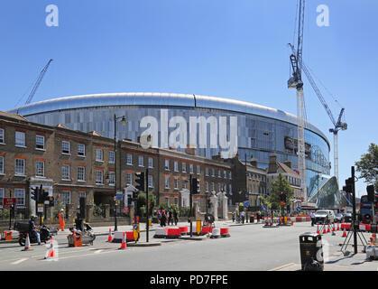 England premier league team Tottenham Hotspur's new stadium dwarfs local houses at White Hart Lane, London. Nearing completion (Aug 2018).