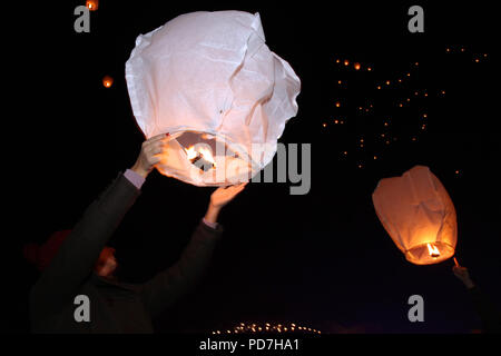 Sky lanterns floating in the sky. Deepavali lights festival. Chinese sky lantern wallpaper. Diwali celebration, the festivals of the light. A Hindu fe - Stock Photo
