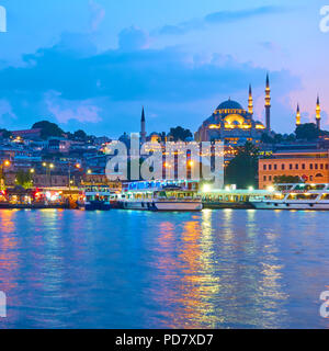 Fatih district with The Suleymaniye Mosque in Istanbul in the evening, Turkey - Stock Photo