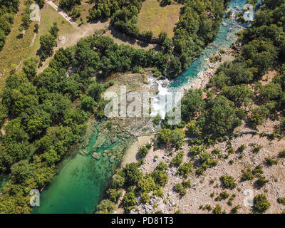 Zrmanja River in northern Dalmatia, Croatia is famous for its crystal clear waters and countless waterfalls surrounded by a deep canyon. - Stock Photo