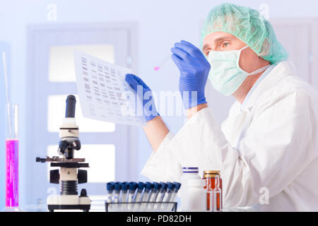 Scientist analizing DNA sequence - Stock Photo