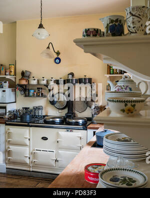 Cream Aga in country style kitchen with cabinets by Kitt Rae-Scott - Stock Photo