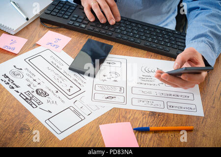 Designer working at new mobile applications - Stock Photo