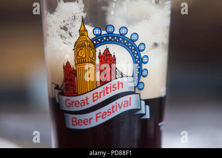 London UK. 7th August 2018. Visitors at the CAMRA (Campaign for Real Ale) Great British Beer Festival Britain's largest beer festival at Olympia exhibition centre. The five day event with around 55,000 people expected to attend and  features over 900 real ales and ciders from around the world. Credit: amer ghazzal/Alamy Live News - Stock Photo