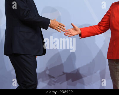 FILED - 07 July 2017, Germany, Hamburg: German Chancellor Angela Merkel (CDU) welcomes Recep Tayyip Erdogan, President of Turkey, to the G20 Summit. The Turkish President will pay a state visit to Berlin on 28 and 29 September 2018. (on dpa 'Erdogan comes to Germany for a state visit' of 07.08.2018) Photo: Bernd von Jutrczenka/dpa - Stock Photo