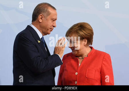 FILED - 07 July 2017, Germany, Hamburg: German Chancellor Angela Merkel (CDU) welcomes Recep Tayyip Erdogan, President of Turkey, to the G20 Summit. The Turkish President will pay a state visit to Berlin on 28 and 29 September 2018. (on dpa 'Erdogan comes to Germany for a state visit' of 07.08.2018) Photo: Michael Kappeler/dpa - Stock Photo