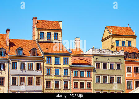 Bright facades of houses with tiled roofs in the historical center of Warsaw, Poland - Stock Photo
