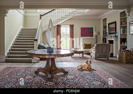 Wide staircase in open plan entrance hall with reception - Stock Photo