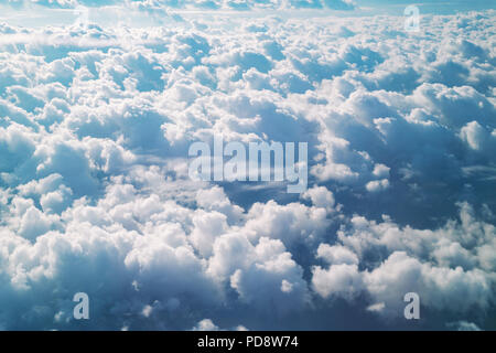 Aerial view from the plane of cumulus rain clouds. Dramatic cloudscape on the Heaven. - Stock Photo