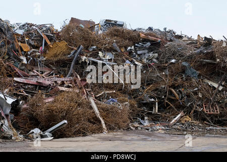 Scrap metal heaped pile collected and delivery to yard for recycling and selling - Stock Photo
