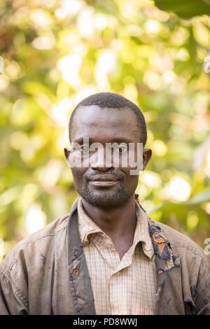 Portrait of a male cocoa farmer in Mukono District, Uganda. - Stock Photo