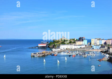 Tenby, Pembrokeshire, South Wales, UK. July 25, 2018.  The beautiful harbor taken from above with yachts and castle at Tenby in South Wales, UK. - Stock Photo