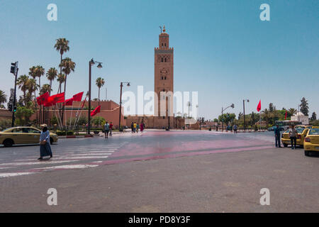 Marrakesh, Morocco - July 25th 2018 : View of Koutoubia mosque surrounded by tourists - Stock Photo