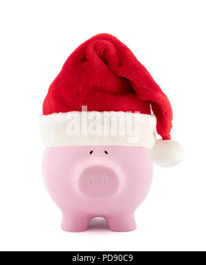 Piggy bank with red Santa Claus hat - Stock Photo