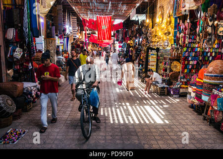 Marrakesh, Morocco - July 25th 2018 : view of crowded old streets of medina - Stock Photo