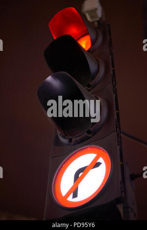 Close up of a traffic light turned red - Stock Photo