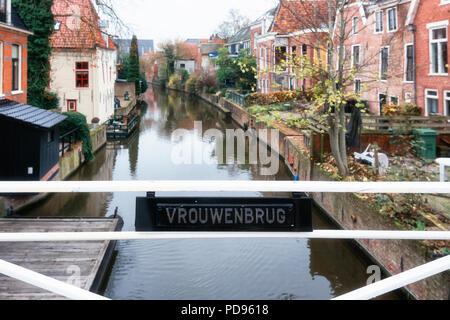 Appingedam, The Netherlands, November 8, 2017: The women bridge over the canal Damsterdiep in the village Appingedam in The Netherlands - Stock Photo