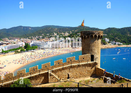 view of beach and town, from the old castle walls in tossa de mar, costa brave, spain. - Stock Photo