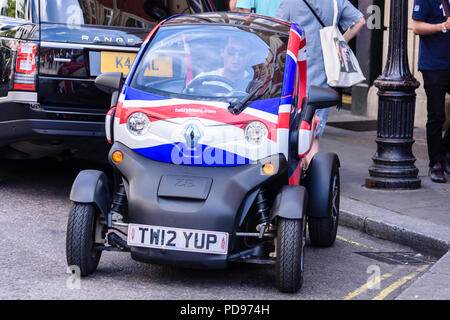 Renault Twizy two seat electric car with Union Jack vinyl wrap used to give tourists a tour around London. - Stock Photo